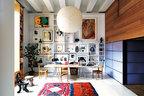 包括主人摄影作品在内的众多艺术品,组成了工作区域的气派背景墙。工作室中,Isamu Noguchi设计的Akari灯笼悬挂在特别定制的白色不锈钢腿橡木桌之上,一旁彩色的的非洲风格珠串脚凳是Philippe Starck的作品,地毯则分别来自摩洛哥和乌兹别克斯坦。满墙的艺术品中,左上角是安迪·沃霍尔的作品,右上角则是Louise Bourgeois的作品。