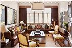 "Michael的公寓多数的窗户常年用咖啡色丝绒窗帘围合着,这个充满""夜之魅""的空间以大地色为主基调,用勃艮第红的皮沙发以及硬质皮箱的茶几,打造了一个男人味十足的空间。选了Philippe Starck设计的手枪台灯,理由有三,男主人Michael娓娓道来:""一,出于电影人的职业习惯,这是詹姆士·邦德所用的经典款;二,武器夺去了很多人的生命,刻着的十字架符号赋予了它更多涵义;三,我喜欢灯座上的这句话':Happiness is a hot gun'。"""