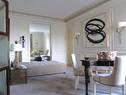"after 后客厅墙面上的艺术作品是2000年由Richard Serra创作的""Line Heat"",近处三面凹陷的游戏桌""Tetre Game Table""是Thomas工作室出品的,三把软包椅子是他为Baker品牌设计的产品。"