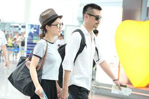 杨子珊牵手老公现身机场 幸福到憋笑眼角眉梢都是爱