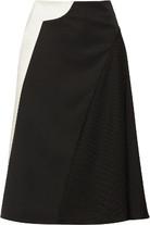 拼接羊毛华达呢和缎布半身裙